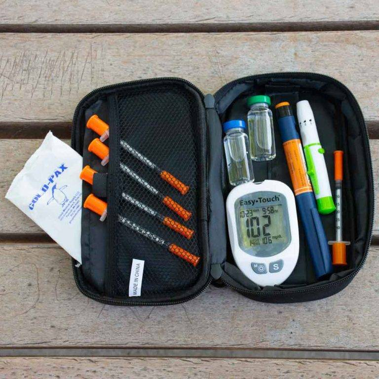 Blue GMS To-Go Above View on Picnic Table filled with Diabetic Supplies