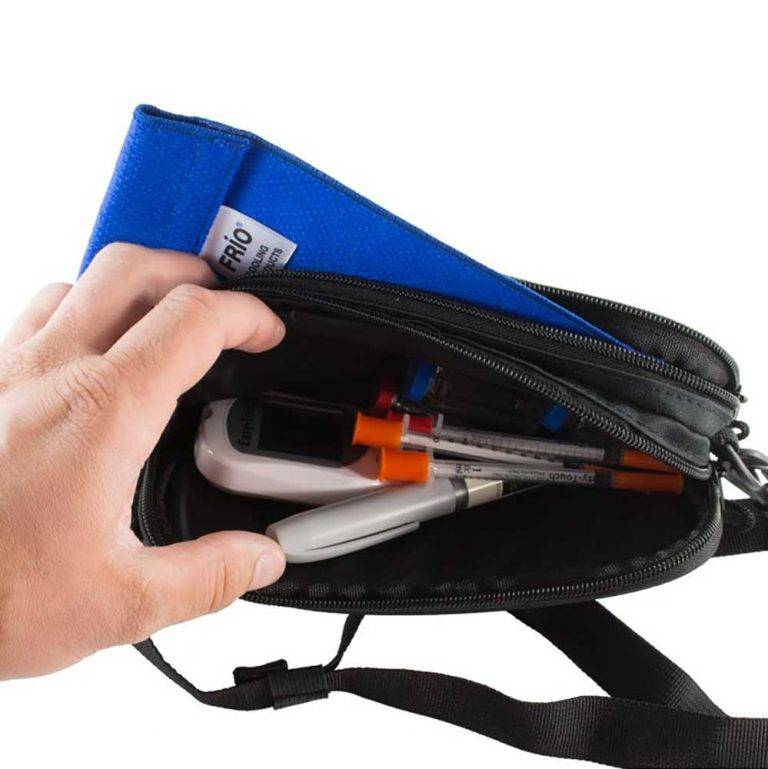 Blue ChillMED Carry-All Diabetic Bag With Cold Pax inside the bag with Insulin Pen and Syringes