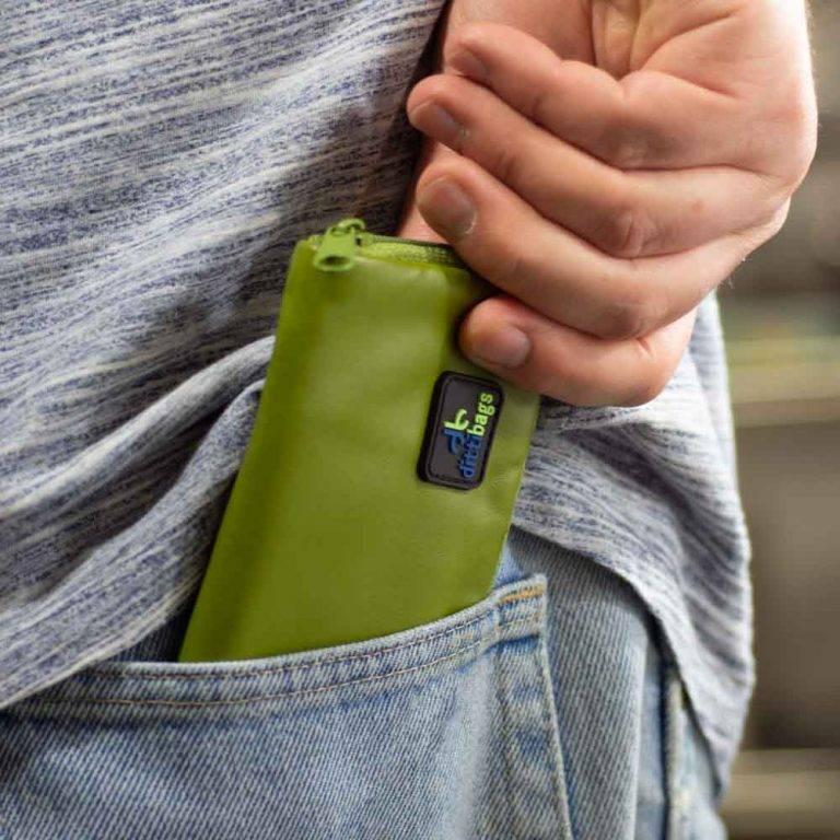 Man putting Green Dittibag into pocket