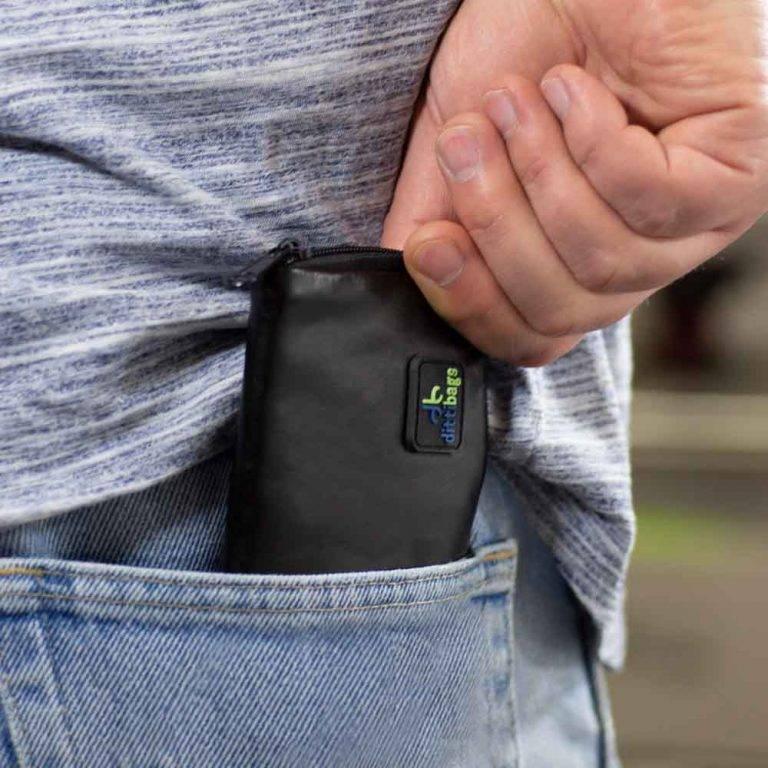 Man putting Black Dittibag into pocket
