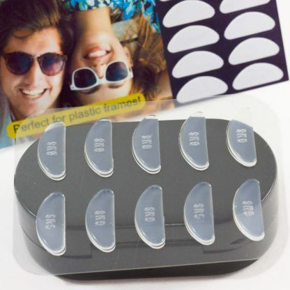GMS Optical Contour Silicone Nose Pads 18mm x 1.5mm Clear in Person's Hand