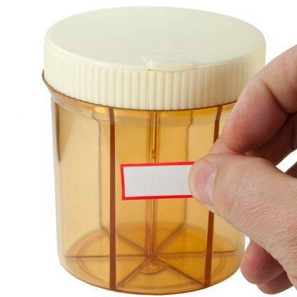 Vitanizer Vitamin Organizer Empty Front View with hand holding label in front of the pill organizer