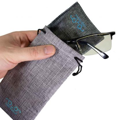 GMS Blue Light Blocking Glasses with hand holding bag filled with glasses and microfiber cloth