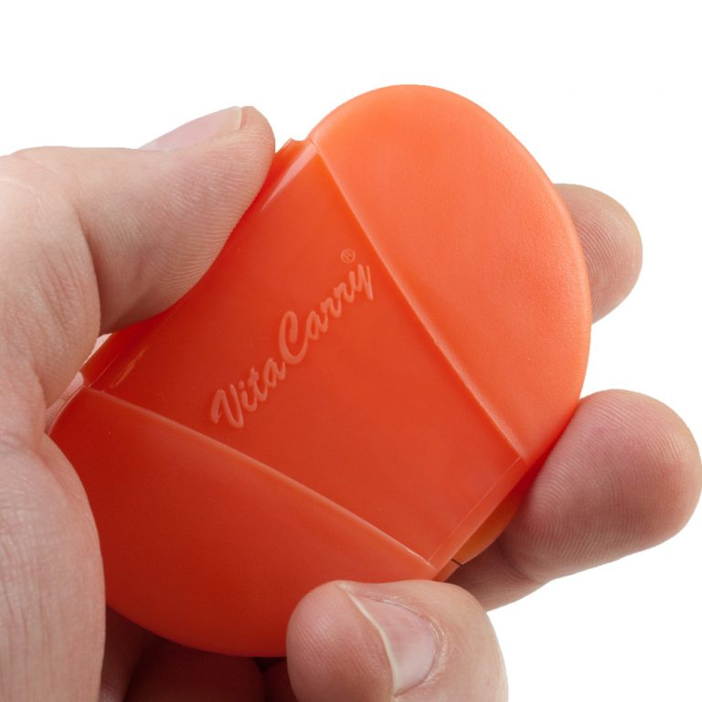Orange Vita Carry Pocket Clamshell Case Closed in Person's Hand