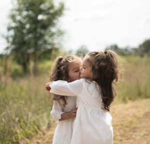 Aleah and Alana Hugging