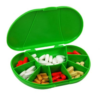 Green vita carry, vitacarry, pill case, pill box, vitamin box, vitamin organizer Open and filled with pills